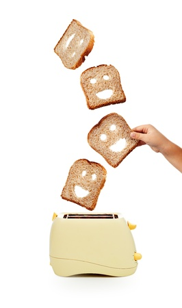 Child hand catches toast bread slices flying out of a toaster - isolated photo