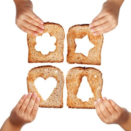 poverty relief: Bread slices with christmas symbols in child hands - isolated