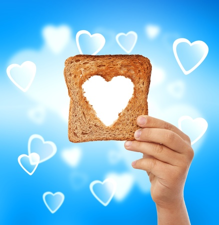 Food with love - help the needy concept with a slice of bread Stock Photo - 11157181