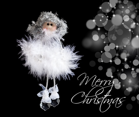 angelic: Fluffy angel and christmas lights on black - seasonal greeting card