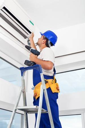 maintenance: Worker finished mounting air conditioning indoor unit