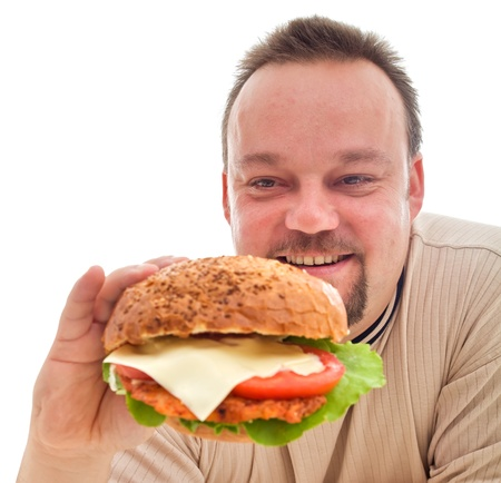 excess: Food addiction concept - happy man in denial phase and his large hamburger Stock Photo