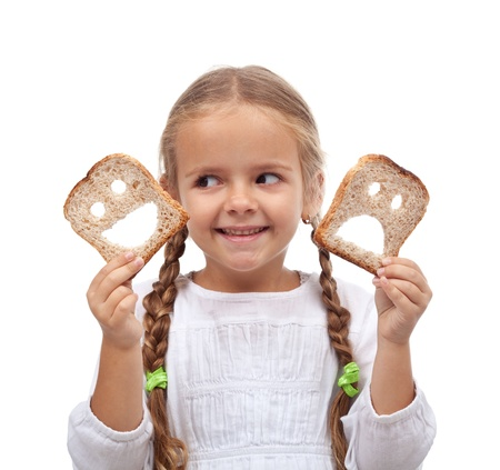 Choices concept - child with smiling and sad bread slices Stock Photo - 11533213