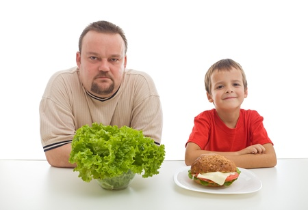 obese child: Healthy diet concept - teaching by example might be hard