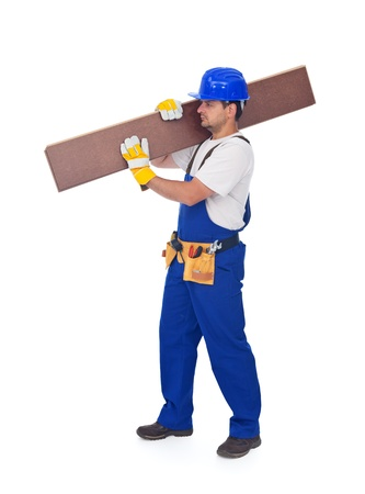 Handyman or worker carrying wooden laminate flooring - isolated with a bit of shadow photo