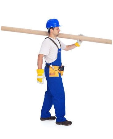 Handyman or worker carrying pipe section - isolated with a bit of shadow Stock Photo - 11988783