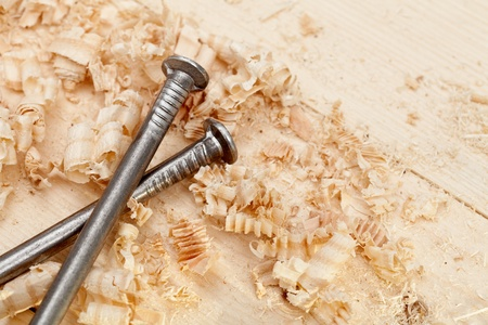 Wood surface, shavings and nails closeup photo