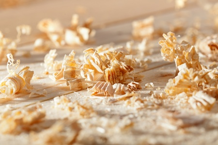 Wooden shavings on the workbench in natural light photo