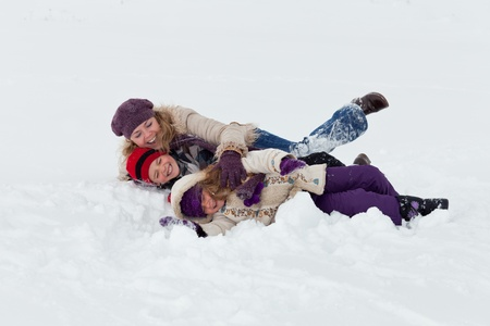 Woman and kids having fun in the snow photo