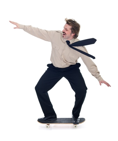 Businessman on skateboard enjoying speed - isolated photo