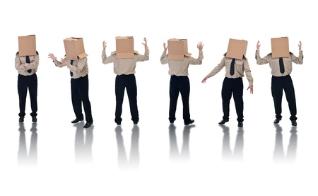 lineup: Six box headed businessman standing on white with reflection Stock Photo