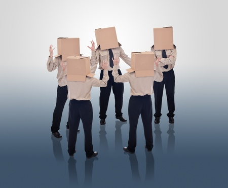 communicate concept: Brain storming businessmen with cardboard box heads Stock Photo