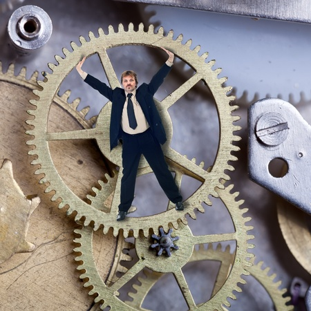 time machine: A small but reliable part of the enterprise - worker inside cogwheel
