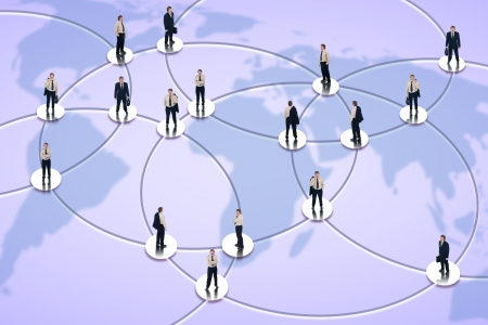 Social networking and global business concept with businessman in the nodes of worldwide network photo