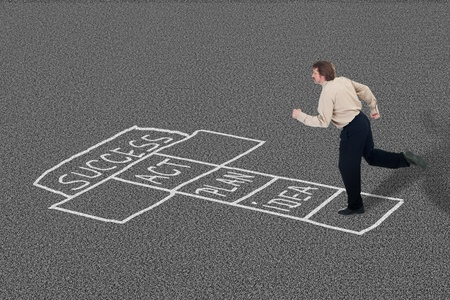 Businessman playing hopscotch towards success taking necessary steps photo