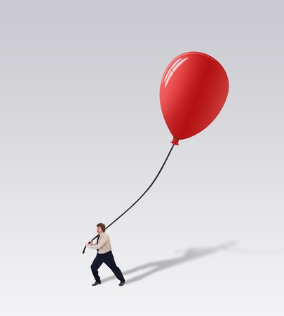 Businessman carry a big balloon - promoting a great new business idea concept photo