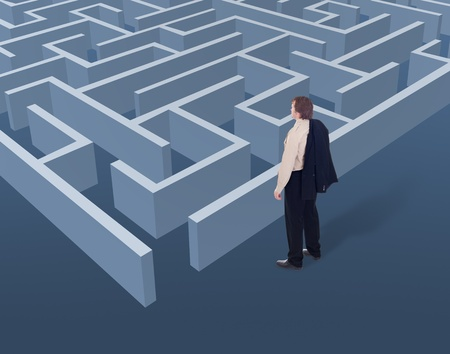 Vision and strategic thinking in business concept - businessman looking to a maze from above  photo