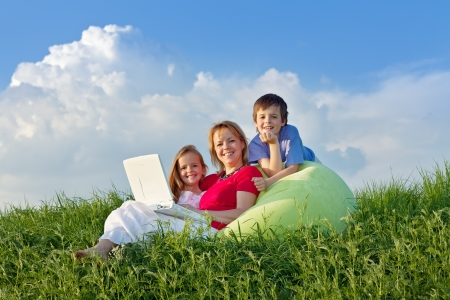 laptop outside: Woman with kids hanging out relaxing outdoors