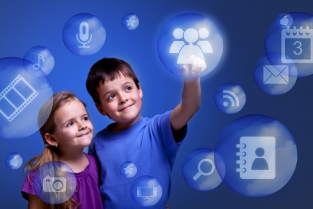 Kids accessing cloud computing applications on virtual three dimensional display photo