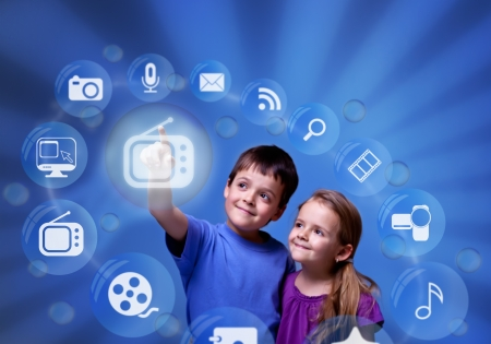 accessing: Kids accessing futuristic entertainment applications from the cloud computing interface Stock Photo