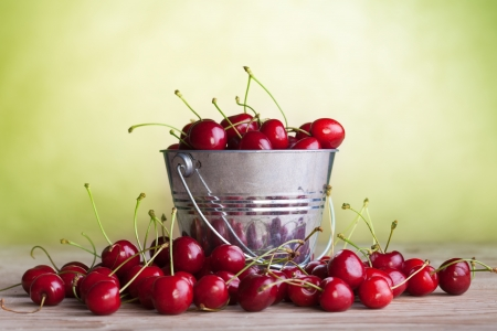 Lots of fresh and juicy cherries on old table