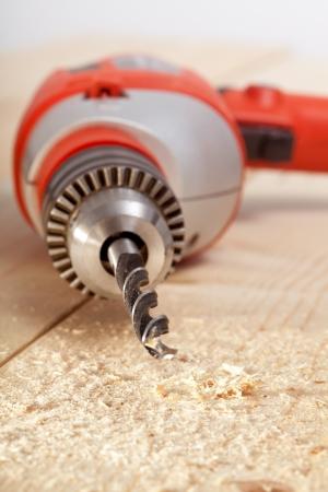 electric drill: Electric drill closeup on wooden surface Stock Photo