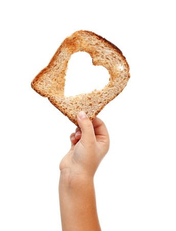 Sharing food with love - child hand with a slice of bread, isolated Stock Photo