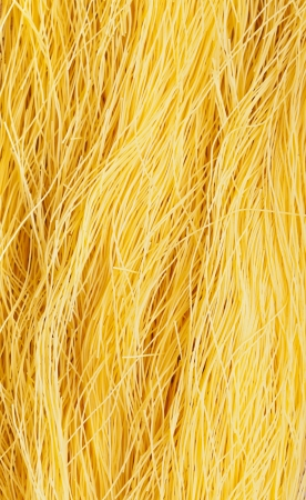 vermicelli: Pasta background - golden yellow vermicelli