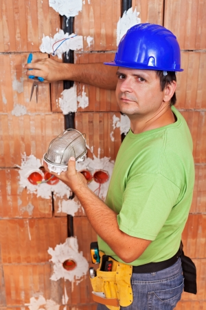 Installing electrical wires - electician working photo