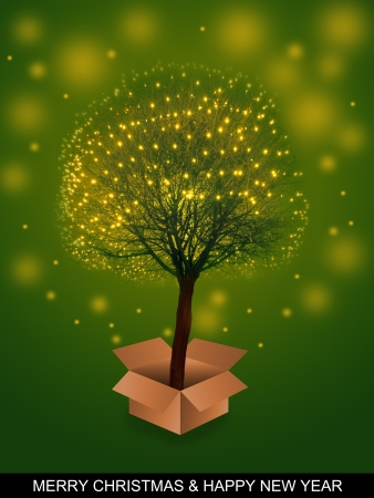 Decorated tree emerging from box surrounded by magical lights - christmas time photo