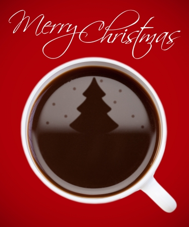 Coffee with christmas tree reflection on red surface photo