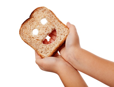 Sharing food - child hands holding happy bread slice, isolated photo