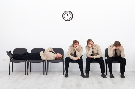 impatient: Bored, stressed and exhausted people sitting on chairs waiting