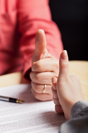Mutually beneficial business agreement concept with hands over contract Stock Photo - 16585083