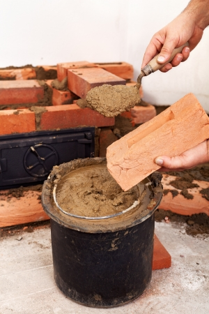 Masonry worker hands closeup - building a fireplace Stock Photo - 16585084
