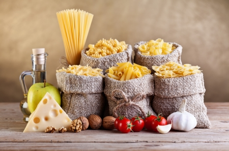 Still life - pasta and seasoning ingredients on old table Stock Photo - 17380446