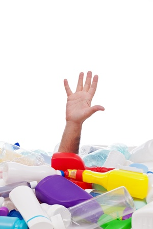 Man drowning under plastic recipients pile - stretching hand for help, environment concept Stock Photo - 17380436