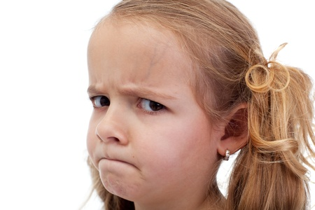 suspiciously: Untrustful little girl looking suspiciously and reprehensive Stock Photo
