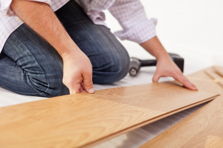Man Laying Laminate Flooring Closeup On Hands Stock Photo Picture