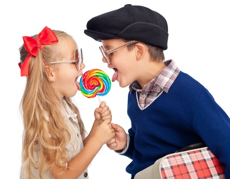 girl licking: Kids wearing funny sunglasses sharing a large lollipop - isolated