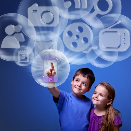 innovation technology: Kids accessing cloud computing applications for mobile device Stock Photo