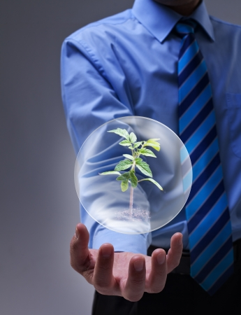 environmental issue: Businessman presenting magical solution to the environmental issue Stock Photo