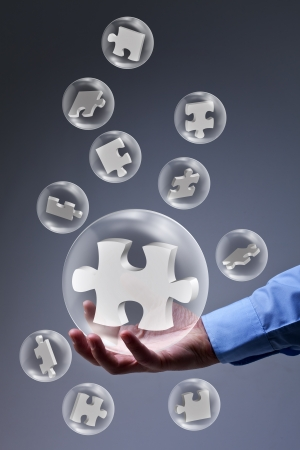 The key piece of a solution concept - puzzle pieces in glass bubbles Stock Photo - 17931691