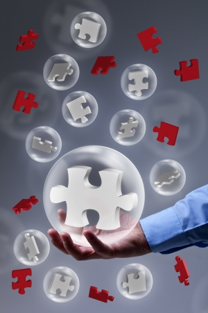 The key piece of a solution concept - puzzle pieces in glass bubbles Stock Photo - 17931692