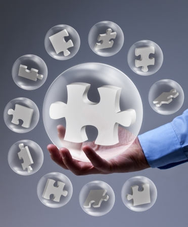 The key piece of a solution concept - puzzle pieces in glass bubbles Stock Photo - 18013876
