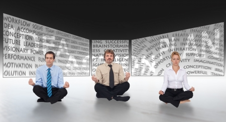 common vision: Brainstorming concept with meditating business people in front of large screens Stock Photo