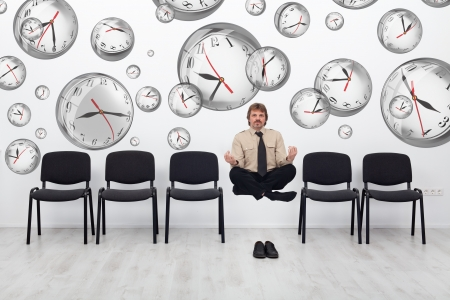 workforce: Project manager juggling with deadlines - surrounded by distorted wall clock bubbles