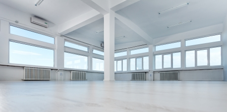 Empty office space with large windows Stock Photo