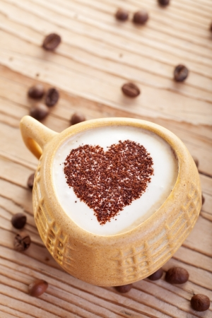 capuccino: Coffee with love - old cup on wooden surface