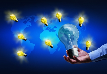 Spreading good ideas concept - businessman hand holding lightbulb over world map Stock Photo - 18787645